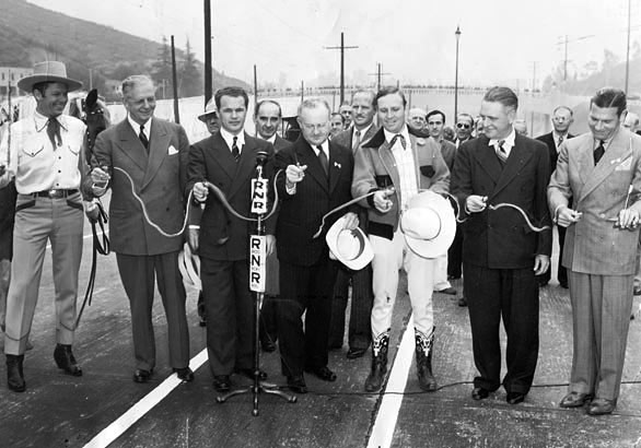 Dedication in 1940 of the Cahuenga Pass Freeway. (L-R) Tom Keene, honorary Mayor of Sherman Oaks; Gov. Colbert Olson; John B. Kingsley, President of the Hollywood Chamber of Commerce; L. A. Mayor Fletcher Bowron; Gene Autry, honorary Mayor of North Hollywood; Burbank Mayor Frank C. Tillson; and Richard Arlen, honorary Mayor of Sunland. (Thanx to Bobby Copeland.)
