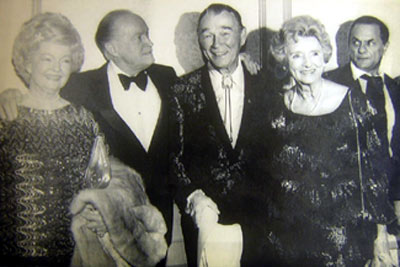"For whatever reason, Tony Curtis looks a little ""peturbed"" as he glances toward Dale Evans, Bob Hope, Roy Rogers and Delores Hope during the Viet Nam Veterans Salute to the USO dinner at the Century Plaza Hotel in Los Angeles on November 12, 1984. (Thanx to Bobby Copeland.)"