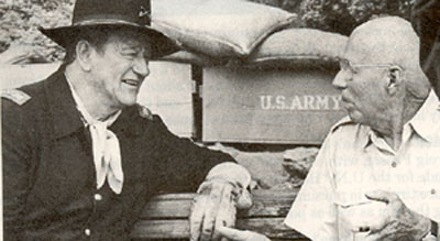 "John Wayne and director Howard Hawks take a break during the filming of ""Rio Lobo"" ('70)."