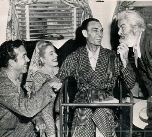 """Yep, it's real,"" says Gabby Hayes as golfer great Ben Hogan playfully tugs on Gabby's beard while John Payne and Mary Beth Hughes have a chuckle. Hogan was recovering in an El Paso, Texas, hospital following a near fatal auto accident in 1949. Payne, Hughes and Hayes were in El Paso for the world premiere of Paramount's ""El Paso"". (Thanx to Bobby Copeland.)"