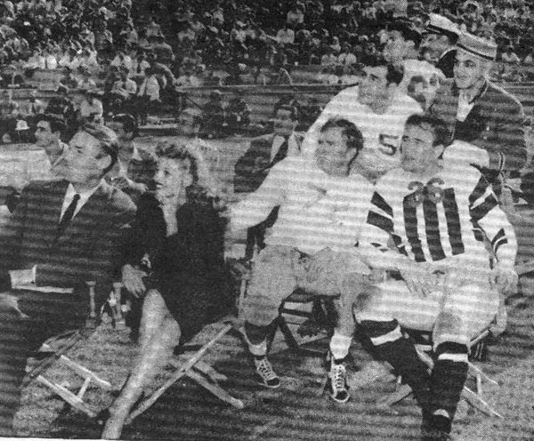 Between halves of the Leading Men-Comedians Football Game, Randolph Scott, Rita Hayworth, Don Barry, unidentified and John Wayne watch film stuntmen put on a musical acrobatic rodeo. Year unknown. (Thanx to Billy Holcomb.)