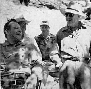 "John Wayne and John Ford enjoy a laugh in Monument Valley while filming ""The Searchers""."
