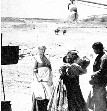 "Olive Carey and Jeffrey Hunter observe as John Ford demonstrates the embrace he wants for a ""Searchers"" scene."