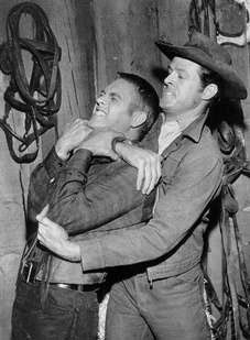 "Robert Culp gets a grip on Steve McQueen on ""Trackdown: The Brothers""."