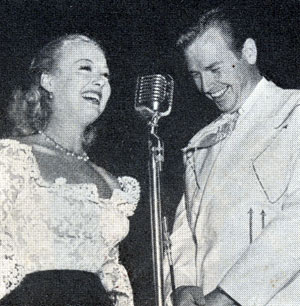 Republic star Adele Mara at a ceremony honoring Republic's new B-western star Rex Allen in 1950.