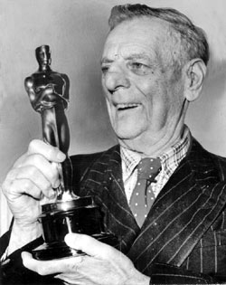 Broncho Billy Anderson holds his honorary Oscar presented to him by the Motion Picture Academy at the 1958 Academy Awards. (Courtesy Bobby Copeland.)