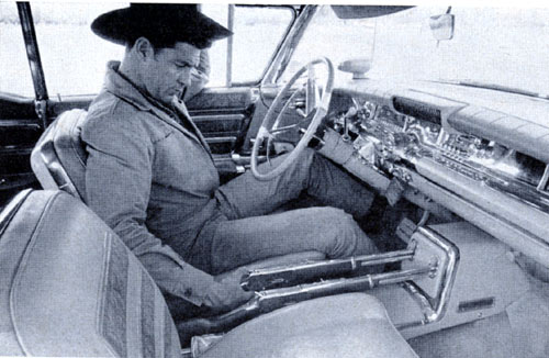 """Tales of Wells Fargo"" star Dale Robertson in the 1959 car given to him by his show's sponsor who equipped it with rifles, cowhide floor and pistols in the door."