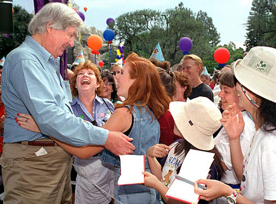 Fess Parker greets fans at Disneyland during its 40th Anniversary Celebration in 1995.
