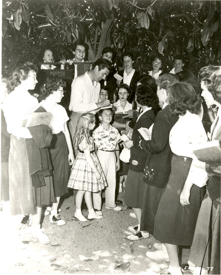 "Fess Parker signs autographs for a group of ""Davy Crockett"" fans."