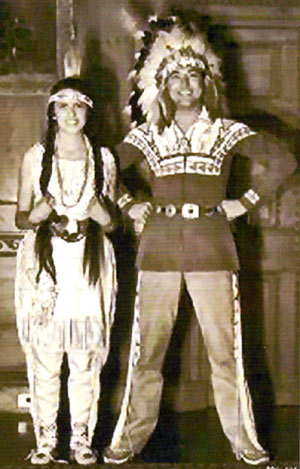 Mr. and Mrs. Johnny Mack Brown dressed as Indians won a costume party at Marion Davies' home.
