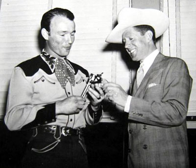 "A young Roy Rogers and crooner Rudy Vallee do a little ""gun-work""."