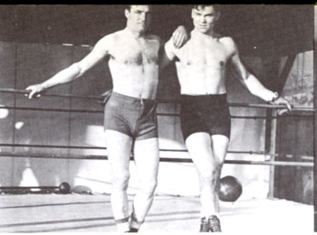 Tom Mix (L) visits boxing great Jack Dempsey for a workout in 1920.