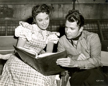 "Beverly Tyler and Audie Murphy study their script for ""The Cimarron Kid"" ('51 Universal)."