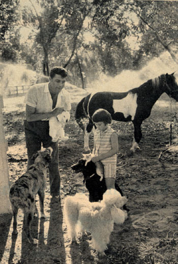 Dale Robertson and daughter Rochelle with their menagerie on Dale's San Fernando Valley ranch in the late '50s.