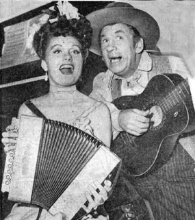 "Kathleen O'Malley, daughter of character actor Pat O'Malley, gets together for a little music with Universal B-western comic Fuzzy Knight on the set of O'Malley's film, ""Lady on a Train"" ('45) which starred Deanna Durbin."