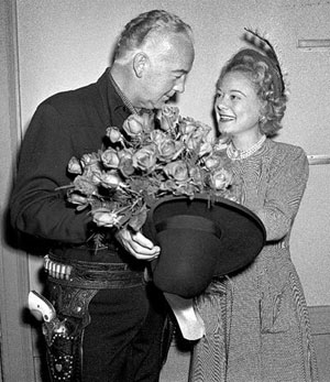 William Boyd as Hopalong Cassidy presents a gorgeous bouquet of roses to Norweigan figure skating champion Sonja Heinie. Heinie won more Olympic and World titles than any other ladies figure skater. (Photo courtesy Bobby Copeland.)