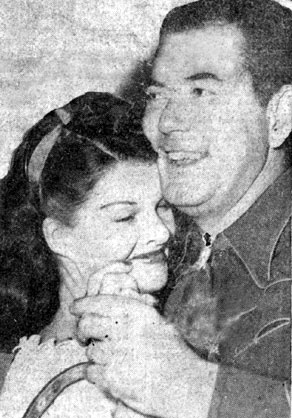 Monogram B-western star Johnny Mack Brown shares a dance with June Horne, Mrs. Jackie Cooper, in November '45.