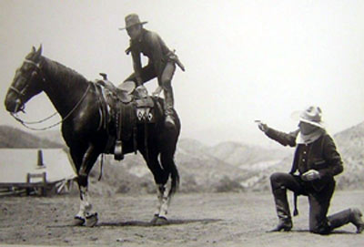 "William S. Hart coaches Johnny Mack Brown on how to do a crouper mount during the filming of ""Billy the Kid"" ('30 MGM)."