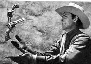 "Republic's B-western star Allan ""Rocky"" Lane practices his gun tricks in this August 1947 publicity photo."