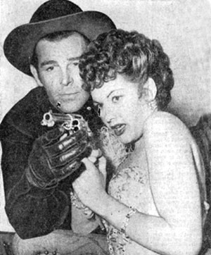 "Yvonne De Carlo gets a lesson in gun-handling from Rod Cameron while the couple were co-starring in ""Frontier Gal"" ('45 Universal)."