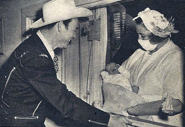 Roy Rogers views his new born son, Roy Rogers Jr., on October 28, 1946. Roy was on route from Chicago at the time of Dusty's birth. Six days after Roy Jr. was born, Mrs. Arline Rogers became ill and died. (Photo courtesy Bobby Copeland.)