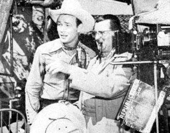 "Director Frank McDonald discusses the next scene of ""Along the Navajo Trail"" ('45) with Roy Rogers."