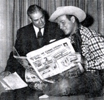 "In July 1952, Roy Rogers and Phillip J. Sheridan of the Hearst Newspaper organization look over the Hearst comic weekly ""Puck"" as they sign contracts for the largest single insertion order of its kind on record. The $75,000 double-truck, four-color spread for Roy Rogers Enterprises as Christmas gift suggestions proposed by 71 firms manufacturing clothing, furnishings, toys and novelties bearing Rogers' brand ran in ""Puck"" around Christmas 1952."