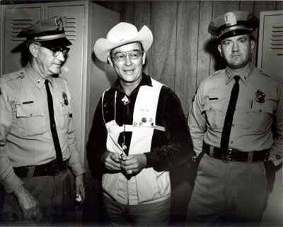Roy Rogers poses in 1966 with Lt. Ralph Staples (left) and Lt. Lee Tye (right) of the Johnson County, Kansas, Sheriff's Department.