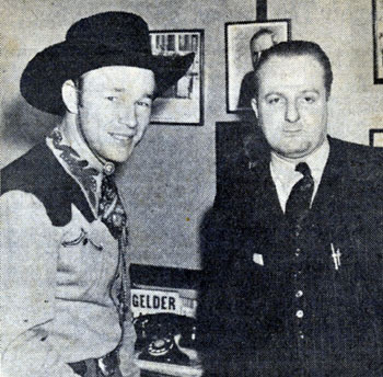 Roy Rogers in 1940 with Larry Stein, District Manager of Warner Bros. Theatres in Illinois, arranging a personal appearance for Roy at the Paramount Theatre in Chicago.