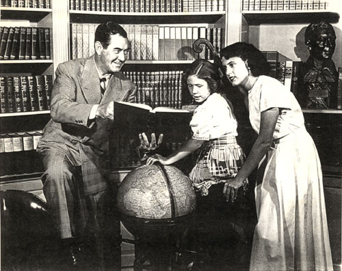 Johnny Mack Brown at home with daughters Cynthia and Janey. Circa mid-'40s.