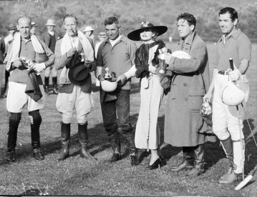 Carole Lombard presents a polo trophy to (L-R) James Gleason, Leslie Howard, Will Rogers, Spencer Tracy and Johnny Mack Brown for their victory over the producers' team in '34 at Uplifters Polo Field in Santa Monica. (Photo from TCM.)