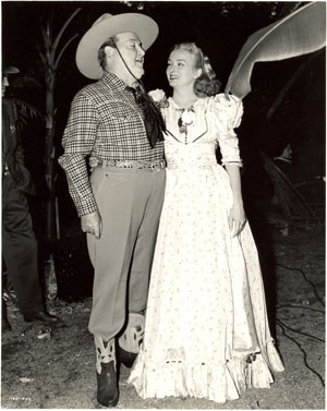 """Riders of Death Valley"" producer Henry McCrae and leading lady Jeanne Kelly take a break between serial scenes."