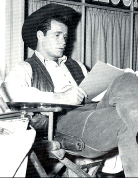 "James Garner studies his script for ""Maverick: Greenbacks Unlimited"" which aired 3/13/60."