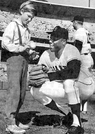 "Young Kurt Russell chats with SanFrancisco Giant's star Willie McCovey at Candlestick Park. Kurt's dad, actor Bing Russell, an ex-minor league baseball player, coached Kurt's Little League team. After high school graduation in '69 Kurt played minor league ball until '73. A promising big league prospect as a second baseman in the California Angels organization, Kurt was leading the Texas League in hitting when he tore his rotator cuff, ending his baseball career. Kurt starred on TV's ""Travels of Jaimie McPheeters"" and ""The Quest""."