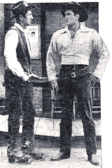 "6 ft. 6"" Clint (""Cheyenne"") Walker with his stand-in, 6 ft. 3"" Clyde Howdy. Note Howdy's fitted step-in sandals with 3"" thick soles strapped to his boots to give him a lift. (Thanx to Terry Cutts.)"