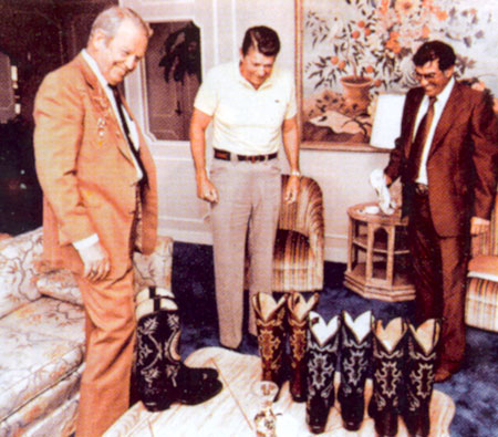 Rex Allen and a Tony Lama representative present President Ronald Reagan with some Tony Lama boots.