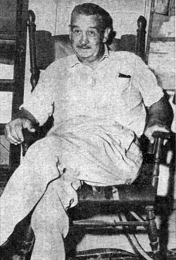 No. 1 B-western screen badman Charlie King relaxes at Lloyd Sparkman's home in Valley View, Texas, about 5 miles south of Gainesville, TX, in 1955. King was born in nearby Hillsboro, TX, February 21, 1895. He was visitor to the area a number of times during the last couple of years of his life. King died May 7, 1957. (Photo courtesy Billy Holcomb.)