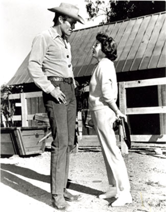 "Chuck Connors talks with director Ida Lupino. Lupino directed the ""Assault"" episode of ""The Rifleman"" in 1961."