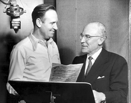 Gene Autry with (I believe) Art Satherly at a 1950 Columbia recording session. (Thanx to Bobby Copeland.)