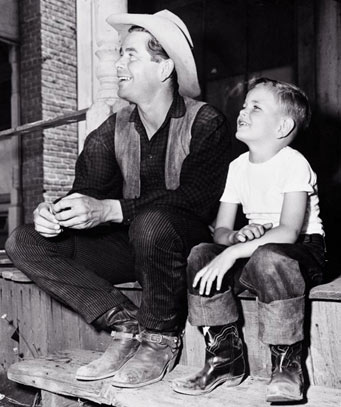A young Peter Ford visits his dad Glenn Ford on location.