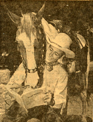 "Eddie Dean and his horse study the script for ""In Old Wyoming"" which became ""Song of Old Wyoming"" ('45)."