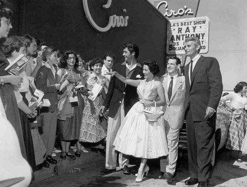 Rory Calhoun (left) and Jeff Chandler (right) attend the opening for Ray Anthony and his Orchestra at Ciro's nightclub at 8433 Sunset Blvd. in West Hollywood in the mid '50s. That's bandleader Ray Anthony beside, we believe, Anthony's band singer April Ames.