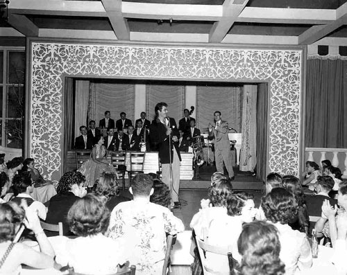 Rory Calhoun emcees for Ray Anthony and his Orchestra at the opening of Anthony's gig at Ciro's in the mid '50s.