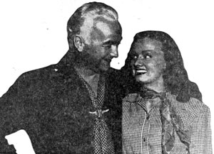 "William Boyd (Hopalong Cassidy) and his leading lady Elaine Riley chit-chat during a break in filming ""The Devil's Playground"" ('46 U.A.)."