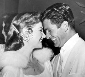 Ann Robinson and Hugh O'Brian share a laugh at a '50s soiree.