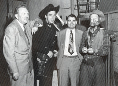 "Behind the scenes of ""The Dalton's Women"" with Western Adventure Productions distributors Joy Houck (left) and J. Francis White between Lash LaRue and Al ""Fuzzy"" St. John."