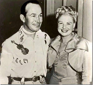 """Your fiddlin' friend"" Spade Cooley and wife Ella Mae in better times. Cooley believed Ella Mae had an affair with Roy Rogers and bludgeoned his wife to death on April 3, 1961. Cooley was subsequently indicted for murder and sentenced to life in prison. After serving 8 years he was about to be paroled in early 1970. However, he died while on a furlough in November 1969."