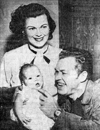TV's Kit Carson, Bill Williams, and wife Barbara Hale with their new daughter Laura Lee in April, 1954.