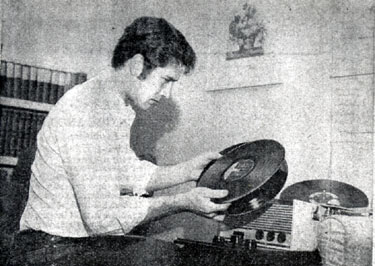 "Bob Fuller of ""Laramie"" in his North Hollywood apartment picking out a few records to listen to. (Thanx to Terry Cutts.)"