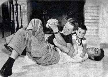 James Arness ambushed at home by sons Craig and Rolfe. (Thanx to Terry Cutts.)